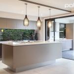 Polytec: Island Bench and Overhead Doors: Caraway Matt. Alfresco Doors and Panels in Belfian Oak