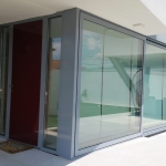 ARCO Double Glazing: Front Door with Additional Lift and Slide Doors in Grey Aluminium